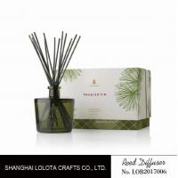 Blackish green color bottle with natural stick and rigid gift box