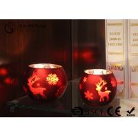 Buy painted ball shape glass candle holder with laser picture with LED tealight at wholesale prices