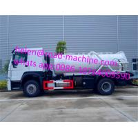 China HOWO 4*2 12,000 Liters Heavy Sewage Suction Truck , White Color Vacuum Suction Truck on sale