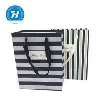 China Fancy Custom Printed Merchandise Bags Craft Rope Handle Unique Design on sale