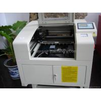 Buy cheap mini laser cutter 4540 type with up and down working table red dot device from wholesalers