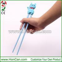 children learning plastic chopsticks with silicone helper